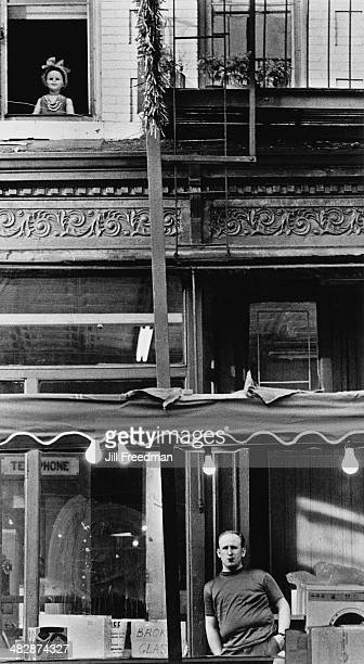 A doll placed in a window in Soho New York City 1969