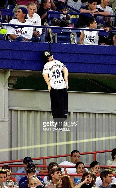A doll representing Atlanta Braves pitcher John Rocker hangs from the stands as the Braves play the New York Mets 30 June 2000 at Shea Stadium in...
