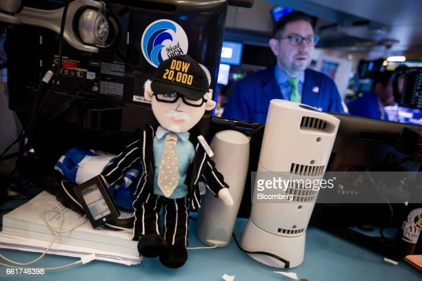 A doll version of Quattro M Securities Inc trader Peter Tuchman is displayed on the floor of the New York Stock Exchange in New York US on Friday...