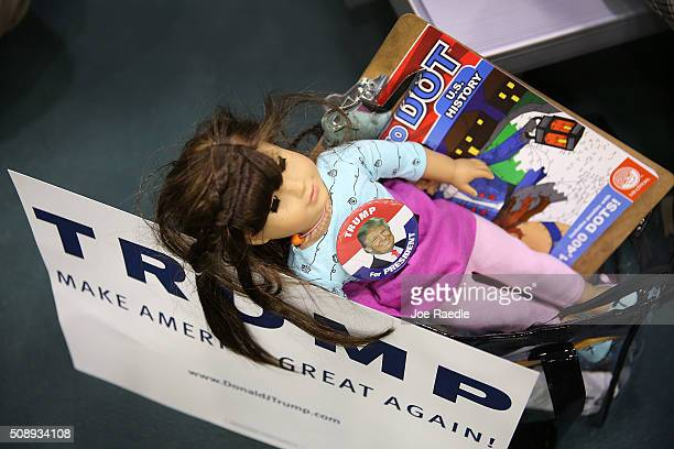 A doll wears a campaign pin for Republican presidential candidate Donald Trump during a campaign rally at Plymouth State University on February 7...