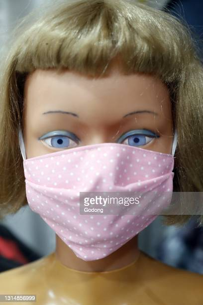 Doll with a surgical mask. Covid-19. France.