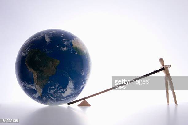A doll with the earth