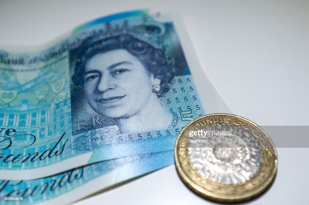 U.S. dollar and British Pound bank notes and are photographed in London on April 29, 2018. The U.S. benchmark government bond yield broke through the psychologically significant 3 percent level for the first time in more than four years.