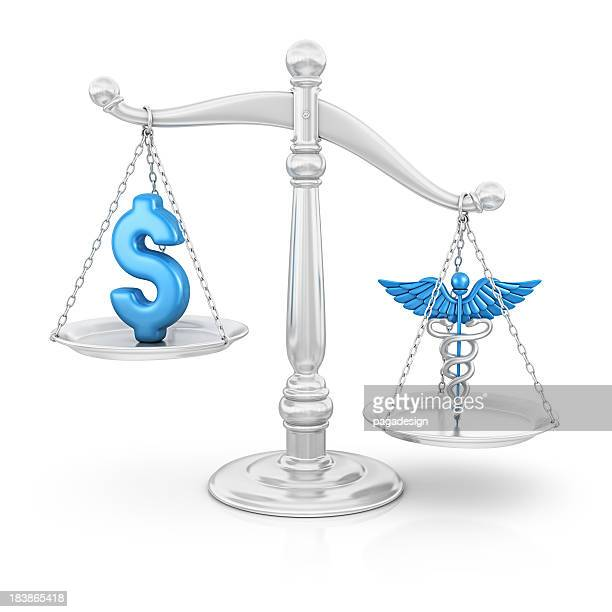 dollar and caduceus on scale