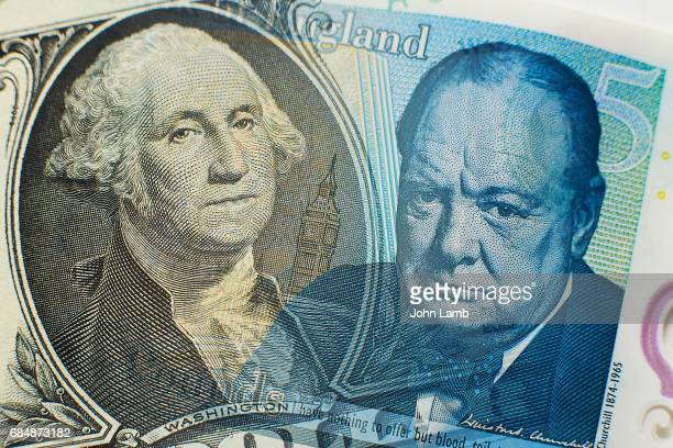 dollar and sterling close-up - us dollar note stock photos and pictures