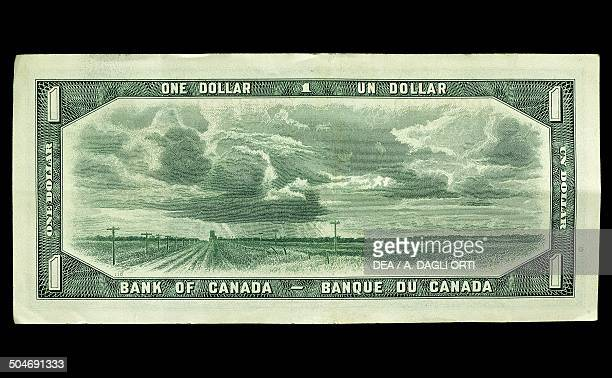 1 dollar banknote reverse landscape and clouds Canada 20th century
