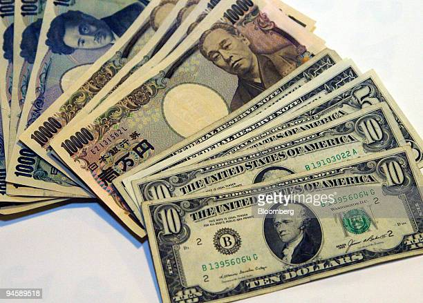 S Dollar banknotes and Japanese Yen banknotes sit in Tokyo Japan Monday November 13 2006 The yen gained the most in a week after Japan's economy grew...