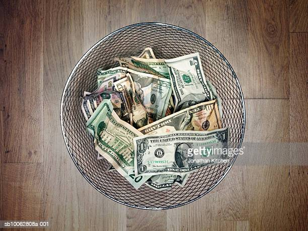 US dollar banknotes in metal bin