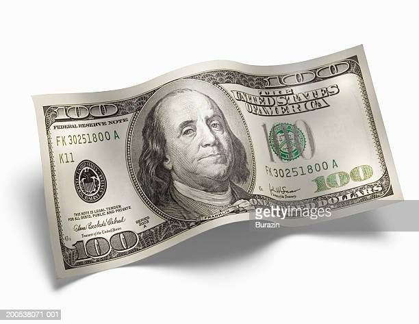 US 100 dollar bill, against white background, close-up