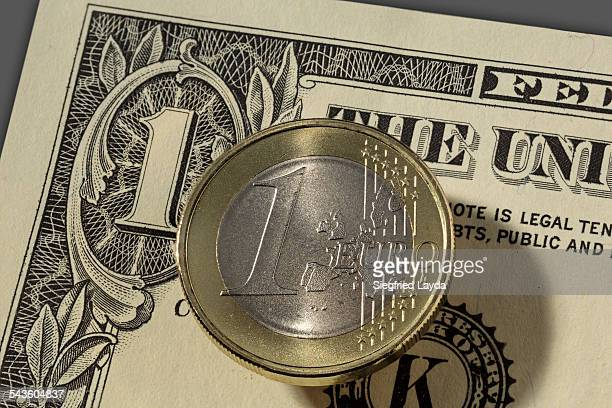 Dollar bill and euro coin