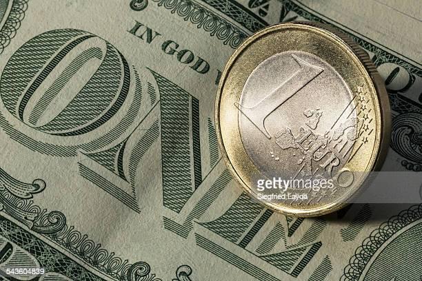 Dollar bill and euro coin