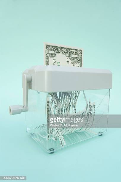 US Dollar bill being shredded