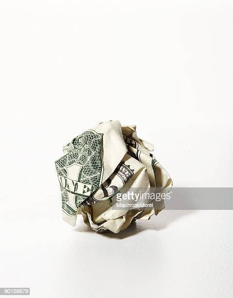 US dollar bill crumpled into a ball