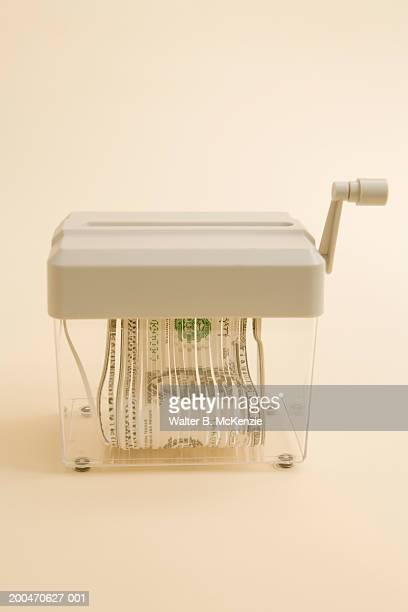 US Dollar bill in shredder
