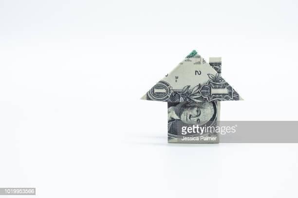 dollar bill origami house - origami stock pictures, royalty-free photos & images