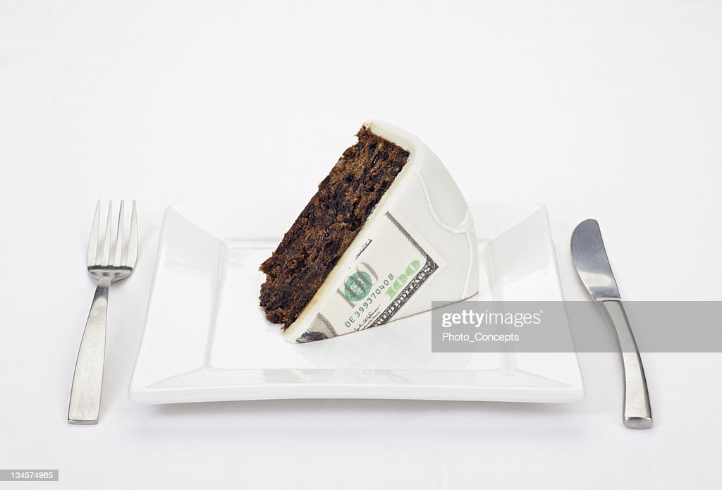 Dollar bill printed on slice of cake : Stock Photo