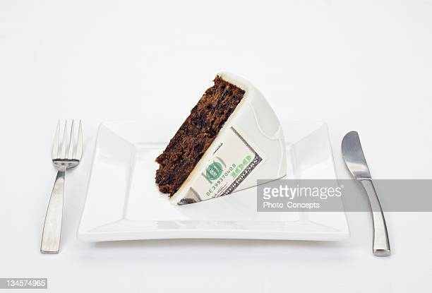 Dollar bill printed on slice of cake