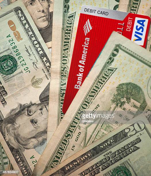 dollar bills and debit card - bank of america stock pictures, royalty-free photos & images