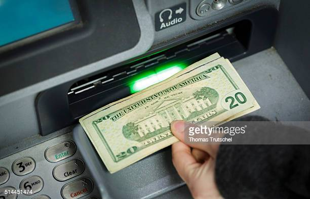 New York United States of America February 27 Dollar bills are taken out of an ATM February 27 2016 in New York United States of America