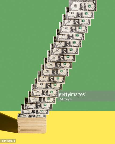 US 1 dollar bills ascending diagonally from stack