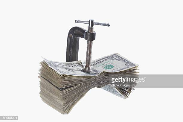 US dollar bills in a vice