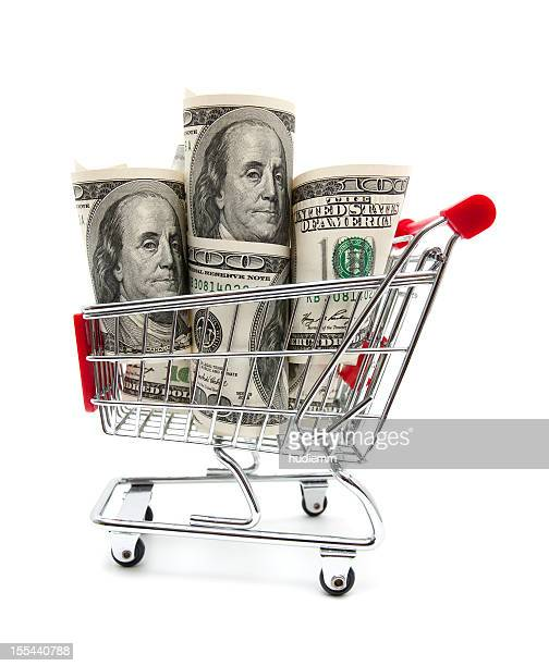 Dollar bills in the shopping cart isolated on white background