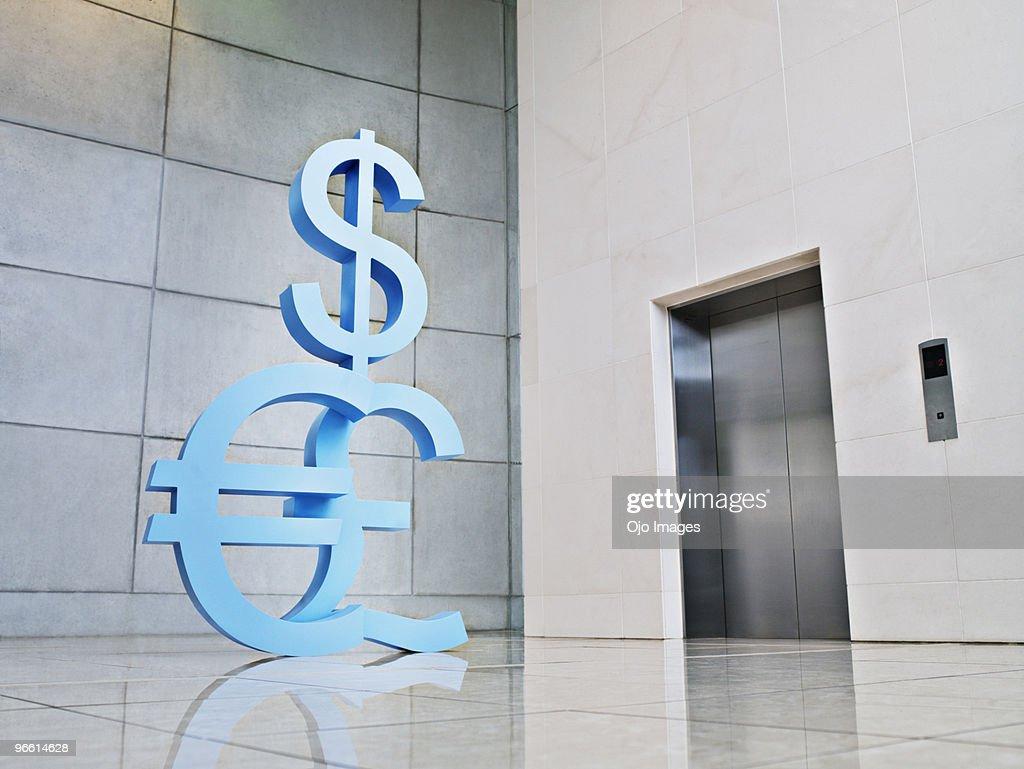 Dollar Euro And British Pound Symbols Near Elevator Stock Photo
