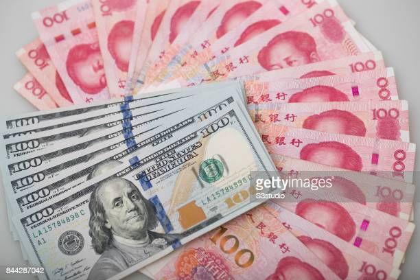 US dollar Franklin and China Yuan of Mao bank notes are arranged for a photograph on 07 September 2017 in Hong Kong Hong Kong