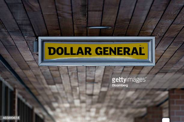 Dollar General Corp signage hangs outside of a store in Rock Island Illinois US on Wednesday March 11 2015 Dollar General Corp is scheduled to...