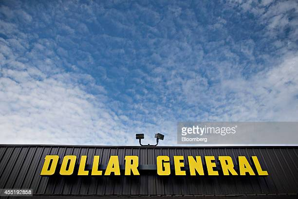Dollar General Corp signage is displayed outside of a store in Colona Illinois US on Wednesday Sept 10 2014 Dollar General Corp spurned twice in...