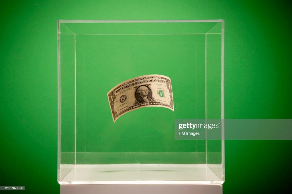 Dollar in a box : Stock Photo