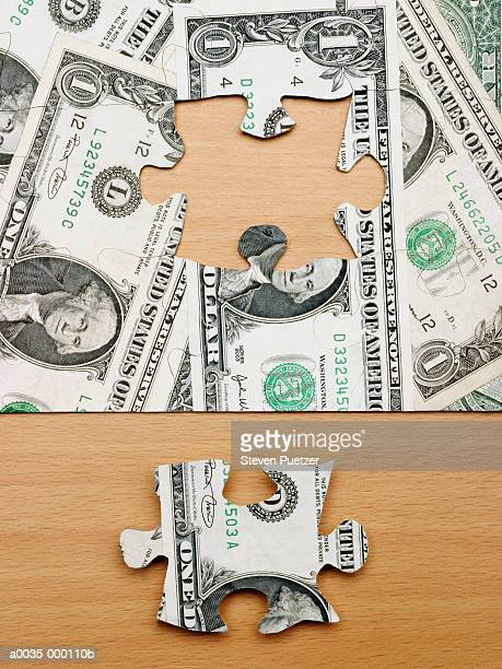 dollar jigsaw puzzle - beëindigen stockfoto's en -beelden