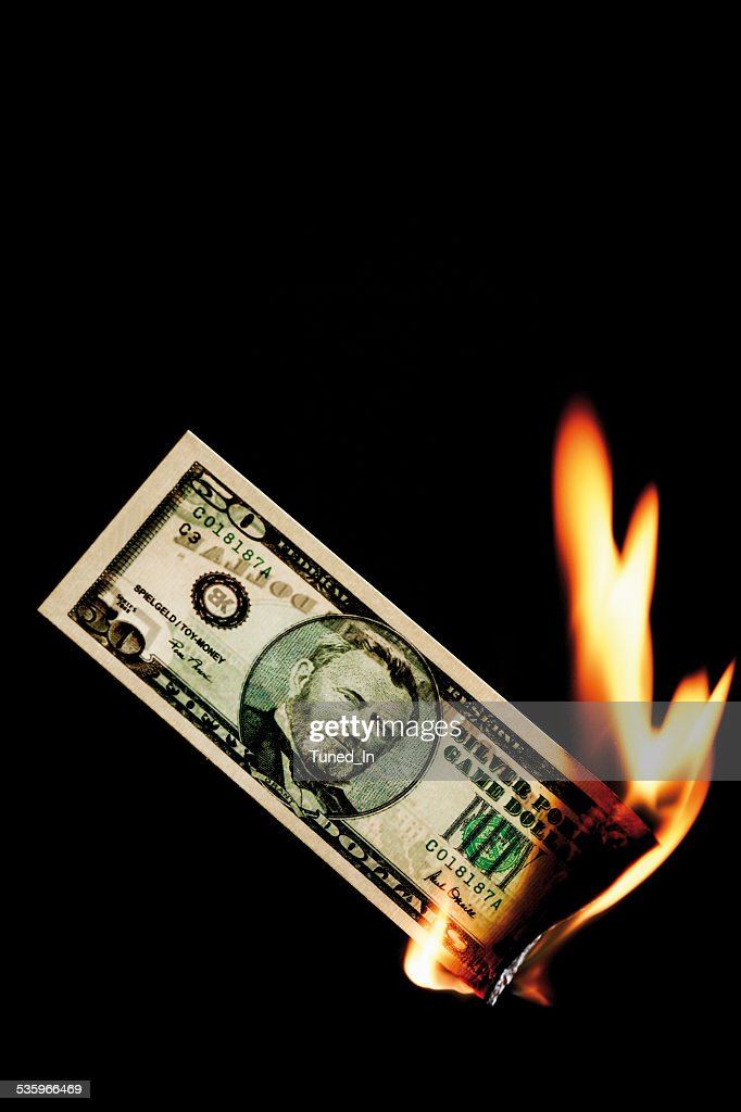 50 dollar note burning against black background : Stock Photo