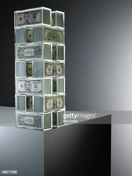 dollar notes in acrylic boxes in a tower - tower stock pictures, royalty-free photos & images