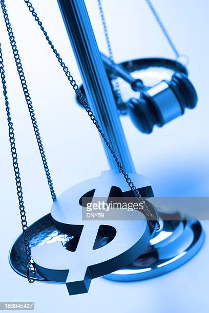 Dollar sign and gavel on justice scale