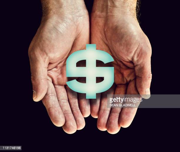 Dollar sign in hands