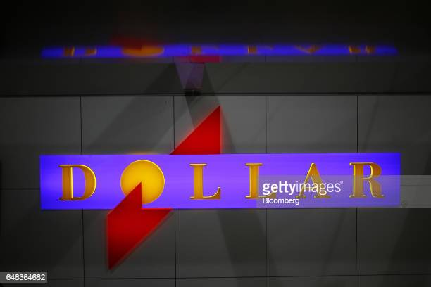 Dollar Thrifty Automotive Group Inc signage is displayed behind a car rental counter inside Indianapolis International Airport in Indianapolis...