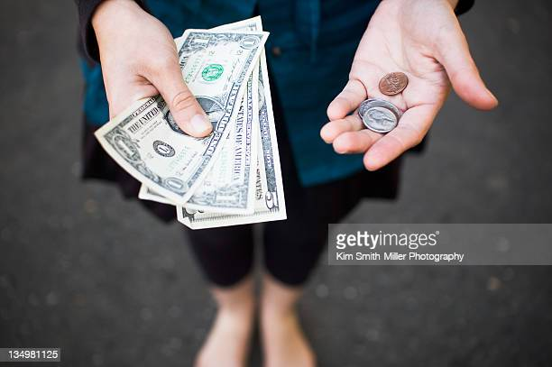 dollars and cents in human hand - us coin stock pictures, royalty-free photos & images