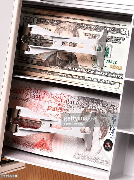 Dollars and pound sterling notes in cash register