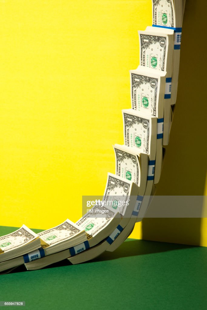 US Dollars climbing a wall : Stock Photo