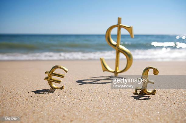 Dollars Euros Pounds Global Currency Sit in Sparkling Sand