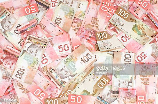dollars - canadian one hundred dollar bill stock pictures, royalty-free photos & images