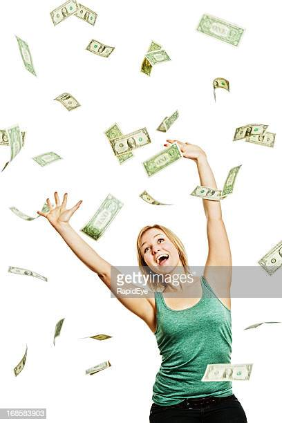 Dollars rain down onto a delighted laughing young blonde