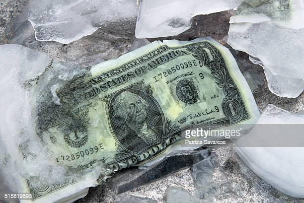 dollars under ice - monetary policy stock pictures, royalty-free photos & images