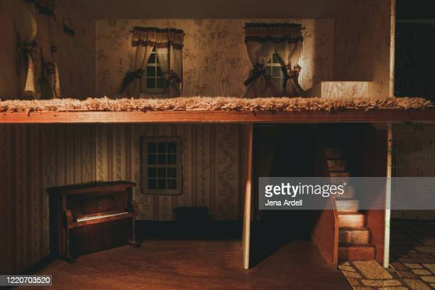 dollhouse: conceptual image for home security, foreclosure and the housing market crisis - dollhouse stock pictures, royalty-free photos & images