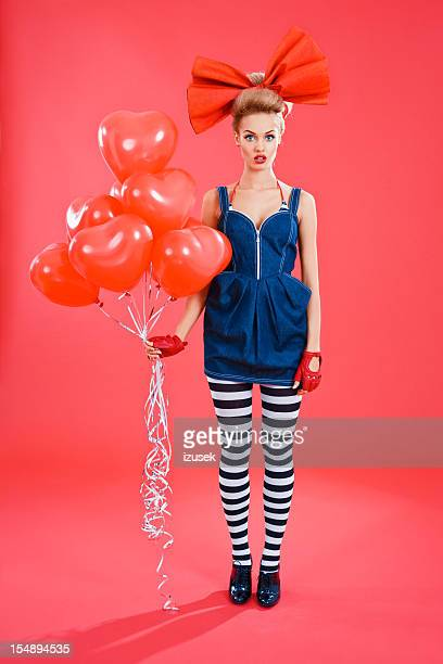 doll-like woman with red balloons - striped dress stock pictures, royalty-free photos & images