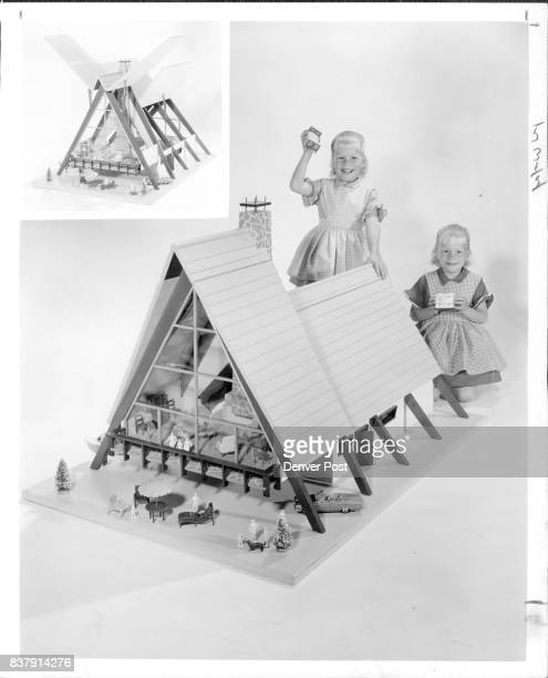 Dolls An enchanted little girl absorbed in a miniature world is a rich reward for the time spent in building this doll house The house shown with...
