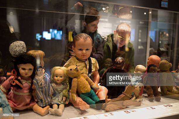 Dolls and stuffed animals belonging to Jewish children victims of the Holocaust are displayed at Children in the Holocaust Stars Without a Heaven a...