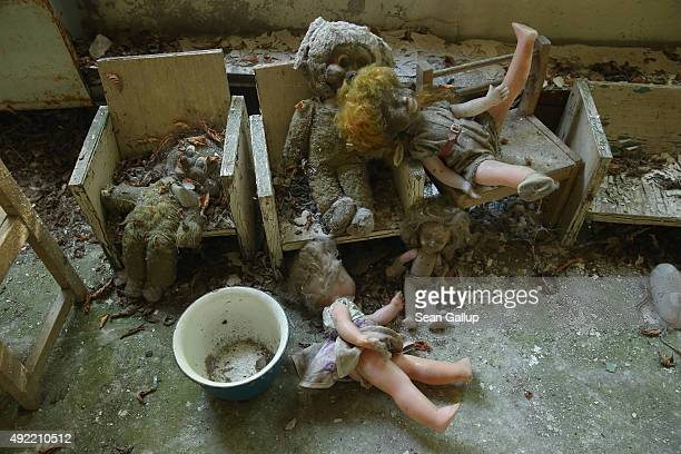 Dolls and stuffed animals lie in the 'Zlataya ribka' abandoned kindergarten on September 30 2015 in Pripyat Ukraine Pripyat lies only a few...