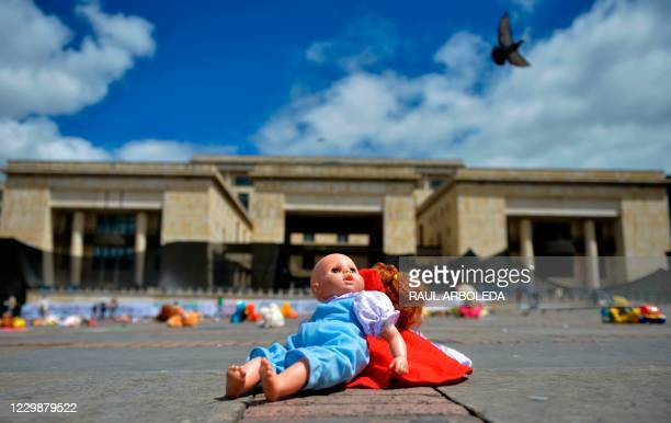 Dolls are placed at the Bolivar square during a demonstration against child abuse in Bogota, on November 30, 2020. - A thousand cuddly toys were...